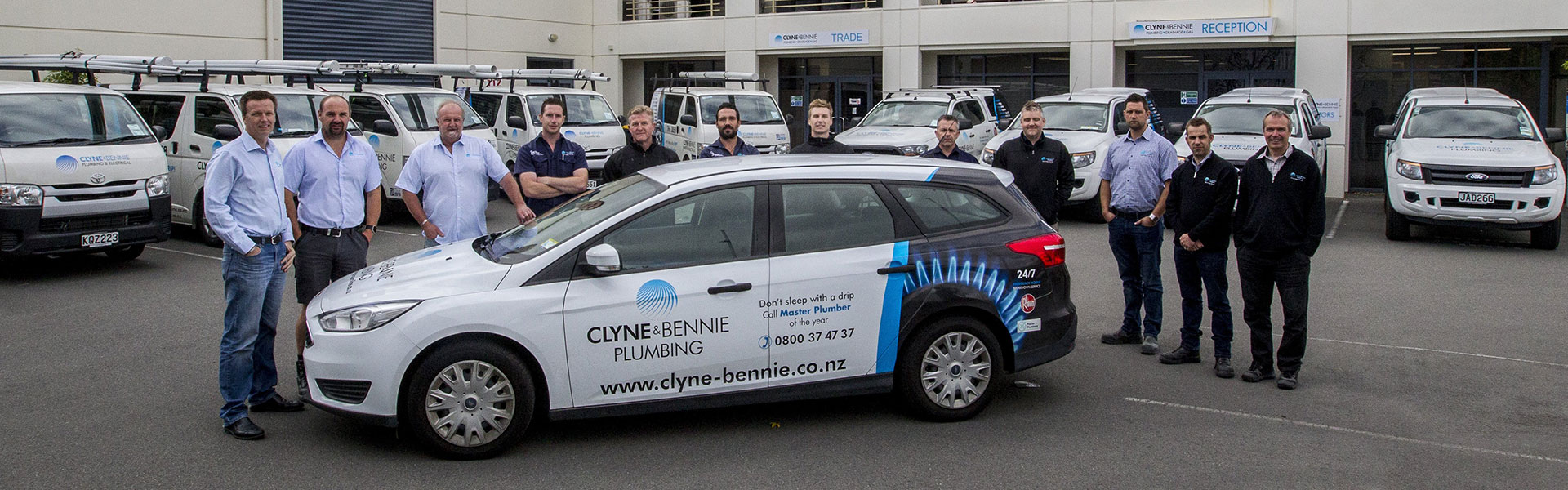 Clyne & Bennie Staff Photo with Signage